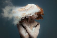 Redhead woman dancer in dust stock images