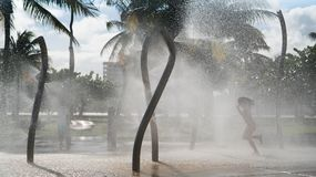 Dancing in fountain girl. Girl is dancing on the fountain and the drops of water are spraying around. Inspiring concept Stock Images
