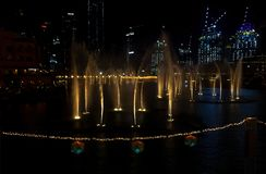 Dancing fountains in focus night background selective focus Dubai UAE. Shallow depth of field.  royalty free stock image
