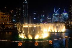 Dancing fountains in focus night background selective focus Dubai UAE. Shallow depth of field. Dubai, UAE - May, 2019: Dancing fountains in focus night stock image