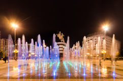 Dancing fountains illuminated at nigth on square Macedonia in Skopje Stock Photos