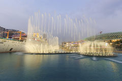 Dancing Fountains in New Sea World Plaza, one of the landmark of Shenzhen, at sunset Stock Photo