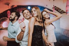 Dancing with Friends. Bar. Handsome Man.Beautiful. stock photos