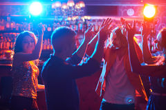Dancing friends Stock Images
