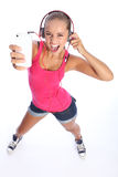 Dancing fun for sexy teenage girl music on phone. Dancing to music on her cell phone a sexy teenage girl wearing denim shorts and pink top looks up singing with Royalty Free Stock Photography