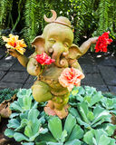 Dancing Ganesh statue holding hibiscus flowers, Thailand Stock Photo
