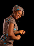 Dancing Ghanese woman. Beautiful young Ghanese african woman showing a dance in her traditional national costume Royalty Free Stock Photo