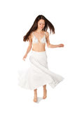 Dancing girl. With twirling white skirt and bikini top Royalty Free Stock Photography
