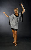 Dancing girl. There is dancing girl looks at you. She wears gray cloth stock image