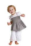 Dancing girl. Cute little girl dancing on her bare feet having fun Royalty Free Stock Photography