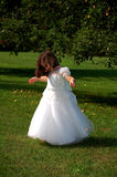 Dancing Girl. Four year old flower girl dancing outside Stock Photos