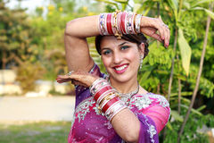 Dancing girl. Indian newly wedded girl dancing outdoor royalty free stock image