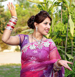 Dancing girl. Indian newly wedded girl dancing outdoor royalty free stock photo