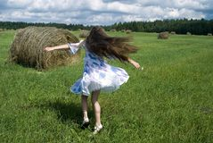 Dancing Girl. The nice girl dancing on  the grass Royalty Free Stock Photos