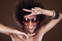 Dancing girl with afro hair Royalty Free Stock Photo