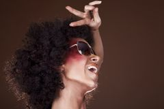 Dancing girl with afro hair Stock Images