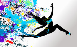 Dancing girl in bright splatters. Royalty Free Stock Photography