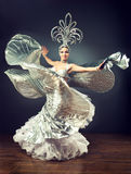 Dancing girl in the carnival costume. Expressive movement of dance.  Brightness of dance Stock Photo