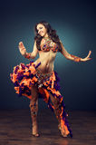 Dancing girl in the carnival costume. Royalty Free Stock Image
