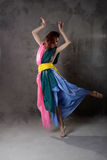 Dancing girl in colorful dress on the dirty grunge Stock Photo