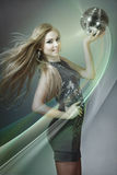 Dancing girl with disco ball Stock Images