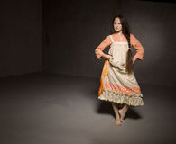 Dancing girl in ethnic dress Stock Photos