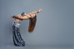 Dancing girl. In a gray traditional dress Royalty Free Stock Photo