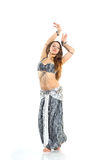 Dancing girl. In a gray traditional dress, isolated image Stock Image