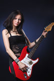 Dancing girl with a guitar Stock Photography