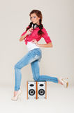 Dancing girl with headphones Royalty Free Stock Images