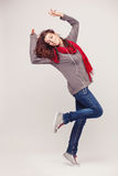 Dancing girl with headphones on light background Stock Images