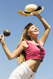 Dancing girl hondling maracas and hat Royalty Free Stock Photography