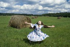 Dancing Girl IV. The nice girl dancing on  the grass Royalty Free Stock Photography