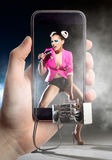 Dancing girl in a mobile phone Stock Image