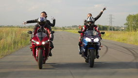 Dancing girl on a motorcycles. Two girls dancing Reggaeton  on the bikes stock video footage