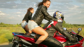 Dancing girl on a motorcycles. Two girls dancing Reggaeton  on the bikesn stock footage