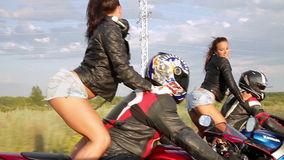Dancing girl on a motorcycles. Two girls dancing Reggaeton  on the bikesn stock video footage