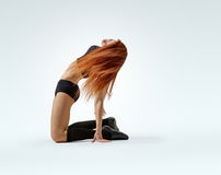 Dancing girl pose on knees Royalty Free Stock Images