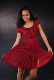 Dancing girl red dress Stock Photography