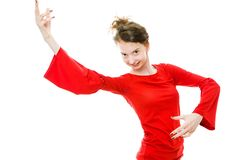 Dancing girl in red dress on white background stock photography