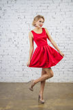 Dancing Girl in red party dress Royalty Free Stock Photography
