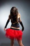 Dancing girl in red skirt Stock Photos