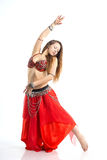 Dancing girl. In red traditional dress, isolated image Stock Images