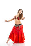 Dancing girl. In red traditional dress, isolated image Royalty Free Stock Photo