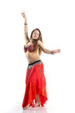 Dancing girl. In red traditional dress, isolated image Royalty Free Stock Images
