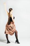 Dancing girl in skirt Stock Photo