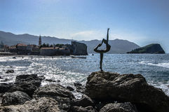 Dancing Girl Statue. An attractive sculpture and popular photo opportunity for tourists on background of old city Budva Stock Photo