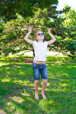 Dancing girl in sunglass with sore knee Royalty Free Stock Photo
