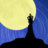 Dancing girl  under the moon Royalty Free Stock Images