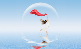 Dancing girl on water surface Stock Photo